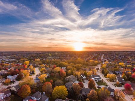 Sunset in the fall over the suburban neighborhood