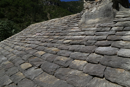 expensive granite: clay tile roof