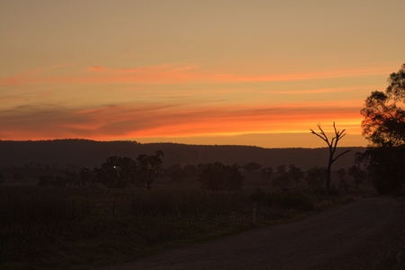 settles: sunset as dust settles in the country