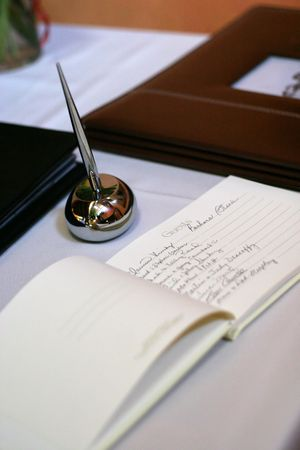 guests: guest signing book at wedding reception Stock Photo