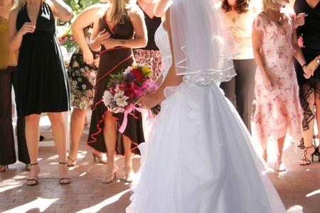 a bride preparing to throw a boquet