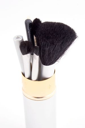 talcum: a group of beauty brushes in a chrome case Stock Photo