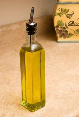 olive oil with biscotti background