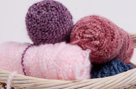 a set of yarn spools in a basket photo