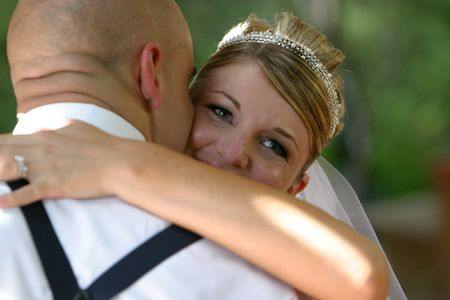 the bride smiles during the first dance