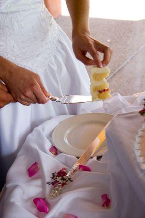 bride steadies the first piece