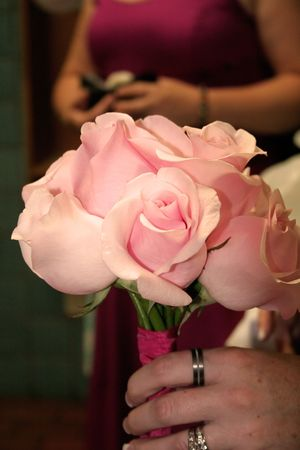 flowergirl: pink roses for the bridesmaid