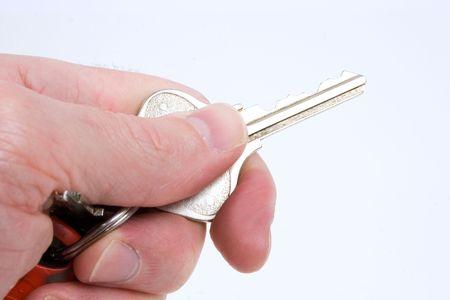 a hand holds a single key photo