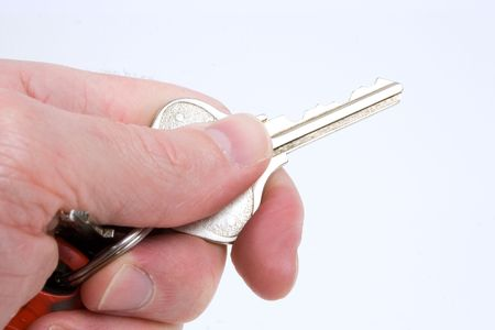 a hand holds a single key Stock Photo