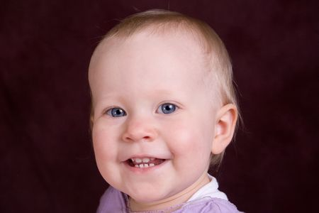 smiling toddler in purple Stock Photo - 334808