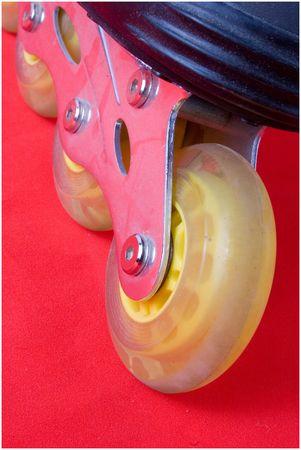 rollerblade: closeup of rollerblade wheels on red