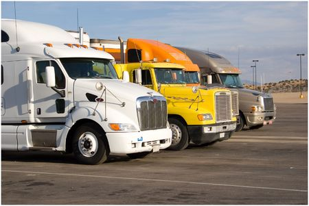 a group of large trucks in a row Stock Photo
