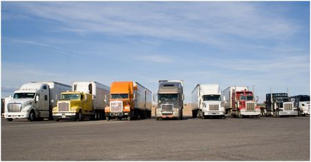 fleet: a group of large trucks in a row Stock Photo