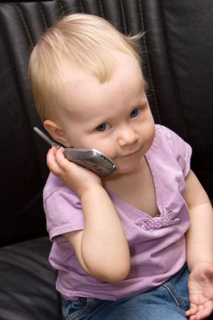 fake smile: toddler on a cell phone