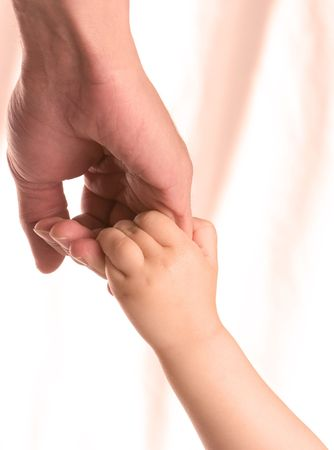 father and child hold hands