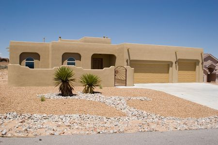 southwestern style house with rock garden landscaping Stock Photo - 793086