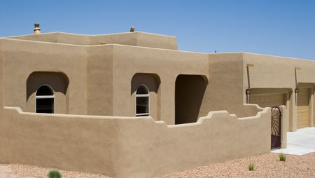adobe home with stucco exterior and privacy wall Stock Photo - 793087