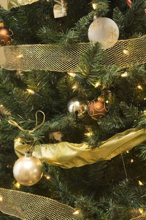 tress: decorated christmas tress with golden ornaments Stock Photo