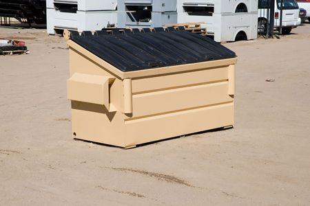 2 cubic yard trash bin in a industrial construction yard photo
