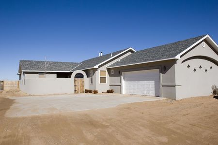 exterior shot of new house for sale. limited landscaping