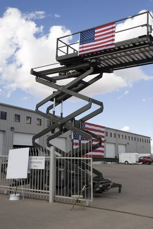 an industrial scissor lift with american flag