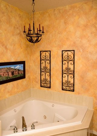 a custom faux finished wall surronds a luxury jetted tub (picture on the wall shot by me) Reklamní fotografie
