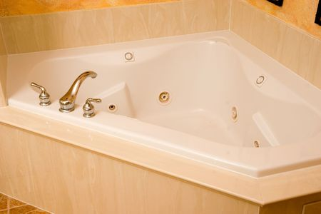 a nice jetted tub in luxury home bathroom photo