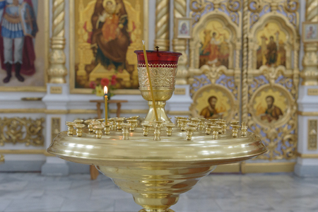 Candila with burning candle in Russian Orthodox Church Editorial