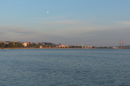 Votkinsk town at sunset with moon