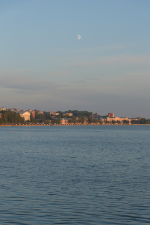 Votkinsk town with Yubileinyi concert hall and moon