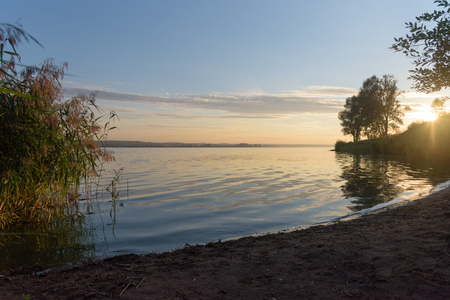Votkinsk lake at sunset in Russia with sun flare