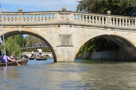 CAMBRIDGE, UK - SEPTEMBER 16, 2018: Clare College bridge with people on punt boats on River Cam