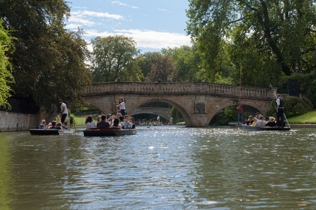 CAMBRIDGE, UK - SEPTEMBER 16, 2018: Clare College and Kings College bridges with people on punt boats on River Cam