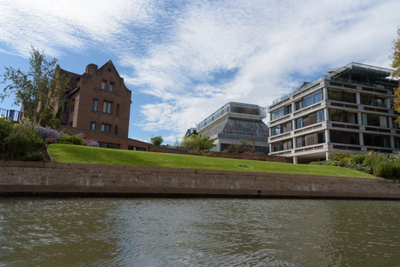 Queens College buildings in Cambridge, England with beuatiful clouds