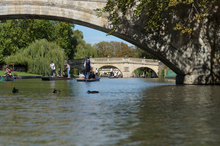 CAMBRIDGE, UK - SEPTEMBER 16, 2018: Kings College and Clare College bridges with people on punt boats on River Cam