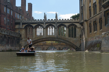 CAMBRIDGE, UK - SEPTEMBER 16, 2018: Punt boat in front of Bridge of Sighs at St Johns College, Cambridge, England Editorial