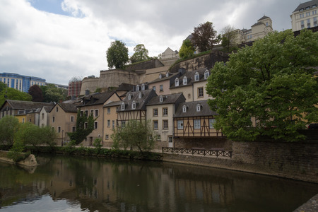 Houses at side of river scene Alzette in Luxembourg from Rue Munster street