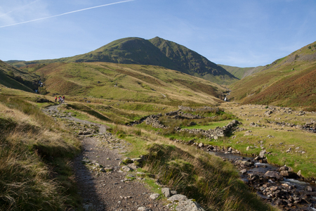 People walking up footpath to Helvellyn mountain near Glenridding, Lake District