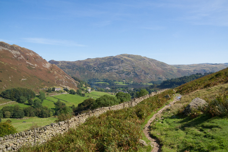 View of Ullswater and Glenridding whilst descending Helvellyn Stock Photo