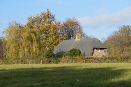 Old thatched cottage in Thurston countryside viewed from public footpath Stock Photo