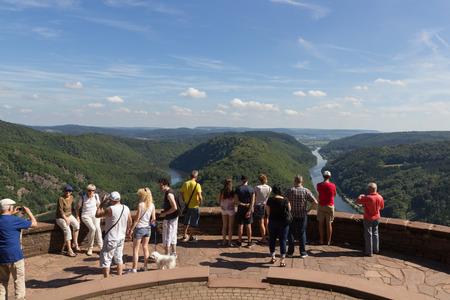 METTLACH, GERMANY - AUGUST 29, 2015 - Saarschleife - People looking at the Saar river curving near Mettlach, Germany