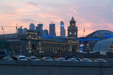 MOSCOW, RUSSIA - AUGUST 2, 2014 - Kiyevskaya railway station, with shopping centre and skyscrapers in backgrouund