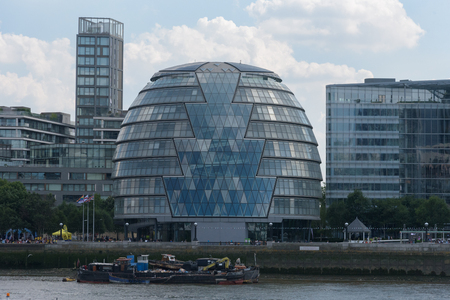 LONDON, UNITED KINGDOM  - JULY 7, 2018 - City Hall viewed from the other side of The Thames river