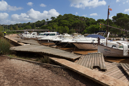 CALA GALDANA, MENORCA - OCTOBER 1, 2015 - Damage to footpath near boats after rain storm