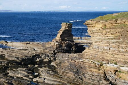 The Tower o' Men of Mey in Caithness, Scotland, UK - Mey Flagstone Formation - Sandstone, Siltstone and Mudstone Stock Photo