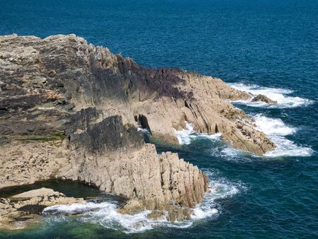 Coastal cliffs in Pembrokeshire, South Wales, UK, as viewed from the Coast Path Фото со стока