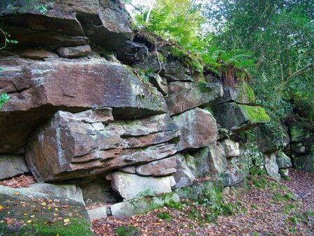 Fractured sandstone next to the River Wharfe, near Strid Wood in the Yorkshire Dales, UK - sandstone of the Pendleian Age in the Millstone Grit Group - sedimentary bedrock formed approximately 328 to 329 million years ago in the Carboniferous Period.