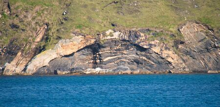 A laccolith rock formation at Lunda Wick, opposite St Olaf's Kirk on the island of Unst in Shetland, Scotland, UK