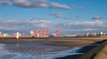 Liverpool2 - a £400 million deep-water container terminal at the Port of Liverpool. New Brighton lighthouse is on the left and Fort Perch Rock appears on the right. Reklamní fotografie