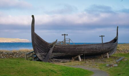 The Skidbladner - a full size replica of a Viking ship found in a Viking burial mound in Norway in 1880. The replica is on show near Haroldswick on the island of Unst in Shetland, Scotland, UK.